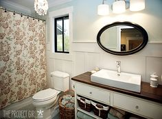 bathroom...love the vanity, horizontal oval mirror, and board and batten