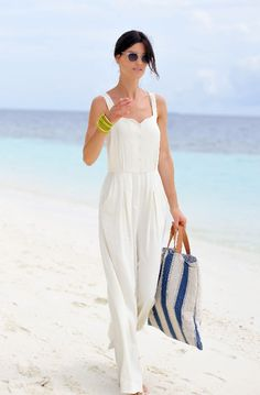 Try a full-length jumpsuit. I love the look of this full-pant jumpsuit in a creamy white. It takes a basic summer romper and instantly updates it. Plus, an all-white ensemble is the perfect summer uniform.