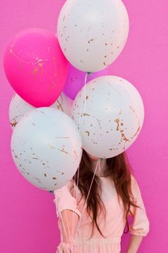 Add gold paint or gold nail polish to  balloons  to jazz it up