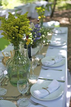 Table settings proper dishes with burlap cloth and some nice flowers.