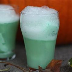 "Slime Punch | ""Terrific easy recipe! I Love the pumpkin idea, only I cleaned mine out and slid my punch bowl inside then decorated the rim of the pumpkin with spiders and worms"""