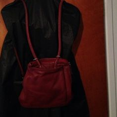 Clarks red soft leather backpack purse Clarks lovely red leather backpack. Preowned in good condition. Zipper pocket on the back. 2 slip pockets and 2 zipper pockets inside straps can be detach so it can also be worn as a crossbody. Very lovely feature. Clarks Bags Backpacks