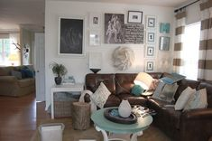 love these colors... more pops of blues tho. But great example of brown couch and cream walls and light wood on floors