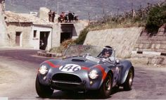 Gurney driving a Shelby Team 289 Cobra in the 1964 Targa Florio, first in class.