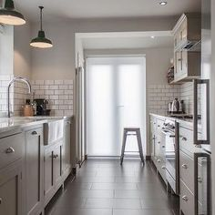 picture kitchen countertops with grays creams and taupes | Stunning gray galley kitchen design with gray cabinets paired with ...