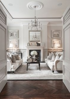 Fresh and spring like formal living room with bright whites and symmetrical styling