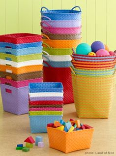 STRAPPING STORAGE BASKETS | $8-$15 EACH:   These bright baskets are great for pops of color in an otherwise plain room or for easily transporting toys from your floor to your closets when guests arrive unexpectedly.