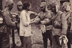 Chinese woman pouring tea for Japanese soldiers.