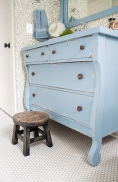 Love this wallpaper from anthropologie and the dresser....Vintage Dresser – Blue and White Bathroom
