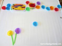 Learn with Play at home: Sticky Table Garden. Low mess, quick set-up, Contact Paper Activity for Kids. This kept both my toddler and preschooler entertained and creating collaboratively for ages.