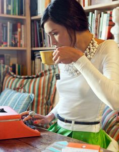 @Julie McCollough - this looks like your perfect life.... a typewriter, surrounded by books, cute clothes and a cup of tea :-)