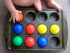 I think we need to buy a bag of balls to play with in our muffin tins.