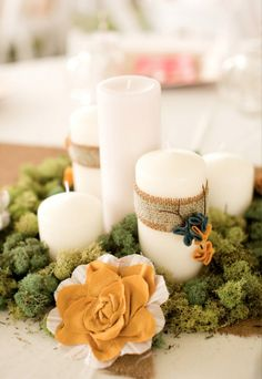 A mossy green candle collection gets a little texture from a simple burlap wrap