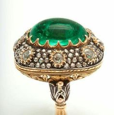 Incredible BUCCELLATI Emerald & Diamond Ring,This unique work of art is comprised of a central emerald cabochon weighing 21.02cts exquisitely set into a rose cut diamond mounting. via 1stdibs