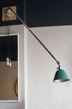 Designed by Johan Petter Johansson, a very rare Mark I/1st edition Telescopic Triplex lamp made of painted steel and porcelain components, with hinged base suitable for wall, floor or ceiling fixing, with telescopic arm whose lenght is adjustable by using the counter-weight, supporting pivoting green enamelled  shade. Swedish circa 1916 Johan Petter Johansson (1853–1943), the …