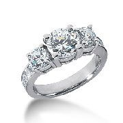 18K Gold Three Stone Rings http://www.weddingbandsworld.com/Three-Stone-Rings_c_101.html