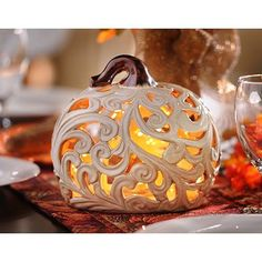 Check out this amazing design on our Cut-out Pumpkin Candle Holder! We love how the intricate cut-out scrolling lets the candlelight shimmer through! #kirklands #harvest