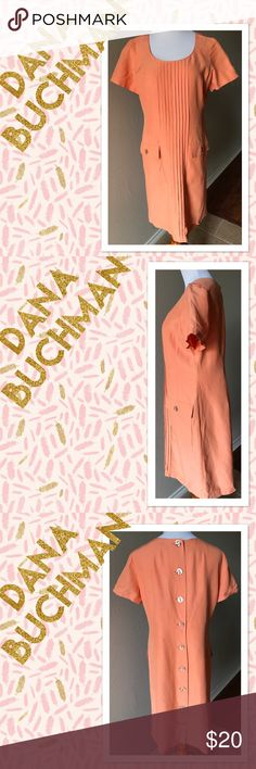 Dana Buchman size 10 coral silk linen dress Made by Dana Buchman this is a size 10 dress. Fabric is blend of silk and linen. Has pleats down front of chest, two pockets on front side, buttons down back of dress. No flaws found Dana Buchman Dresses Midi