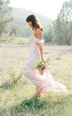 Diaphanous floral wedding dress. La la la la la, kicking through the meadow on a lovely sunny morning. Lucky her