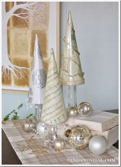 Paper Christmas Trees  tutorial { elsewhere in her blog this blogger has the tutorial for the tree artwork in the background, it's seen in the livingroom of part 1 of the latest 'Twilight' movie}