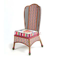 Create a garden-party mood all season long with the Flower Market Outdoor Dining Chair. Solid iron frame, hand-woven in an intricate pattern of pink, green, and blue, accented in black and white.