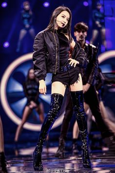 Asian singer onstage in thigh boots