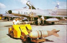 A bomb load of M117 for an F-100D Super Saber at Tuy Hoa AB, during the Vietnam conflict.