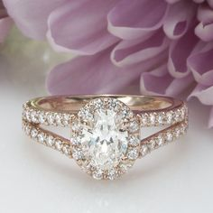 We're obsessed with this rose gold, oval halo engagement ring with split shank! Get this ring from Inter-Continental Jewelers in Houston.