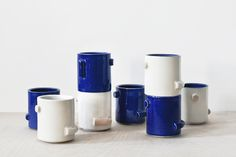 """$52 Confetti Cup 52.00 Designed by High Gloss Color: Blue* / White Mix** Dimensions: H 3 1/2"""" x D 3"""" Material: Ceramic (stoneware)"""