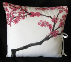 Cherry Blossom Pillow Cover. This awesome, Asian inspired designer pillow makes a perfect accent throw for a sofa or bed! It features a hand-painted design of a sumi-e inspired cherry blossom tree branch on white heavy duty cotton twill. The inside has been lined with a white polyester lining to give it that finished touch. The pillow cover ties closed on the side giving it a unique style.