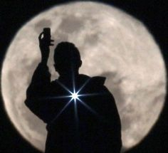 July 6, 2012: A man photographs the full moon in Brasilia, Brazil, on July 3, 2012 (© Ueslei Marcelino/Reuters)