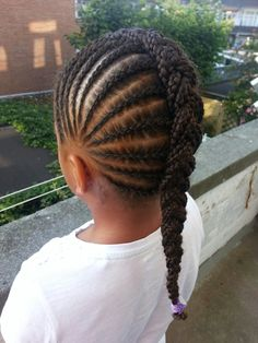 Little girl cornrows braided into large French braid. Very neat and unique!