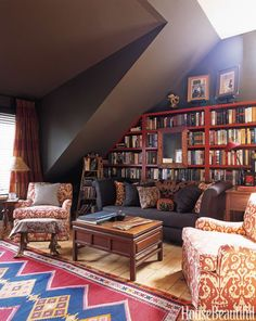 Designer Amanda Kyser has filled Long Island home's library with artistic details. The Molina sofa from Bespoke is covered in Arabica Belgian linen from Libeco-Lagae, and the pillows are a mix of antique silk ikat and 19th-century Thai patterns. Walls are painted Dark Taupe and bookcases are Merlot, both by Benjamin Moore.