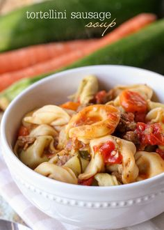 Tortellini Sausage Soup - a new favorite! { lilluna.com } Packed with lots of flavor, including sausage, veggies, & tortellini tossed in lots of spices!