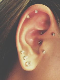 My newest daith piercing! Alongside forward helix, double cartiledge, tragus and triple line piercings