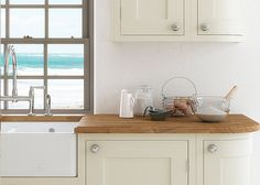 Baystone solid ash shaker style inframe kitchen in Cream – First Impressions