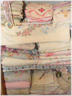 Not my closet of linen keepsakes, but I have the exact pink rose embroidered pillow case and dresser scarf set like on this top shelf. Must have been a popular pattern.