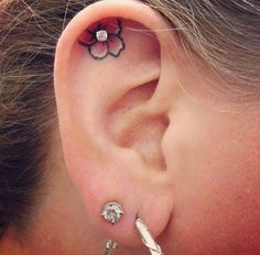Ear Piercing With Flower Tattoo