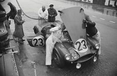1955. 2nd place, #23 factory-entered Aston Martin DB3S in a pit stop.