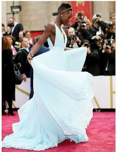 Lupita Nyong'o at the 2014 Oscars in a beautiful blue custom Prada grown