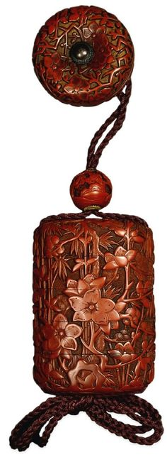 Inro (4 case): tsuishu lacquer, decorated with bamboo, pine tree, and peach blossoms; inside nashiji. Ojime: tsuishu lacquer; a sage instructing a youth. Netsuke: manju shape, tsuishu lacquer; peach blossoms. 18thC-19thC: