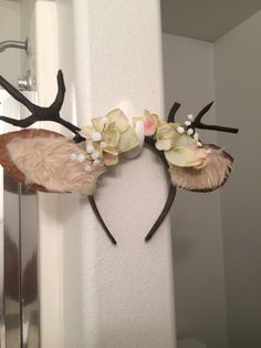 Cute deer antlers I created out of pipe cleaners, brown floral tape, an old headband and some decorative flowers at the craft store.