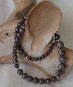 Brown Snowflake Obsidian Necklace by anncarrolldesign on Etsy, $51.00  I am often asked for chocolate colored natual stone in a necklace or earrings. Here is a necklace with lovely creamy white inclutions (snowflakes) in an natural volcanic glass. There are compianion earrings to go with this necklace.