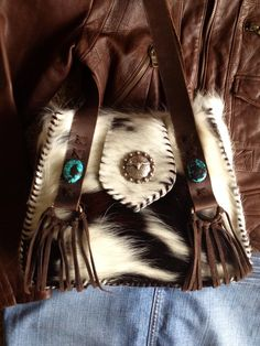 """Lady Lillian's. The smallest Bonnie Bag design measuring 11"""" wide, 9"""" high and 4"""" deep.  Cowhide, turquoise stone on flap and suede fringe. gowestdesigns.us"""