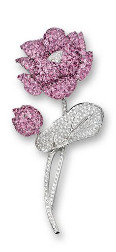 2015 - PINK SAPPHIRE AND DIAMOND 'FLOWER' BROOCH Modelled as a lotus flower, the petals and bud set with circular-cut pink sapphires, the flower centre, stalk and leaf decorated with brilliant-cut diamonds, the pink sapphires and diamonds together weighing approximately 16.00 and 1.70 carats respectively, mounted in 18 karat white gold.