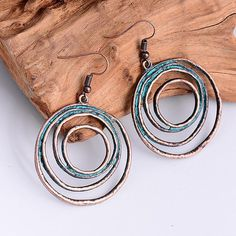 Vintage Style Bohemian Copper Round Drop Earrings #theroguesclothes #boho #vintagestyle #turqoiseandcopper https://theroguesclothes.com/products/vintage-antique-gold-color-round-earring-charm-pendant-bohemian-punk-style-copper-drop-earrings-creative-girls-jewelry