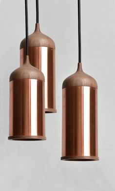 Copper and Wood Pendant Lights by Steven Banken. The walnut top fits neatly onto the copper tubing, which bounces light around for a warming effect. Wood Pendant Light, Copper Pendant Lights, Copper Lamps, Copper Lighting, Cool Lighting, Lighting Design, Pendant Lighting, Chandelier, Pendant Lamps