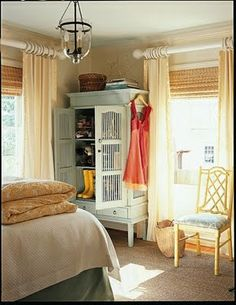 cute soft yellow and blue bedroom. big chunky curtain rod. Via Cottage Living.