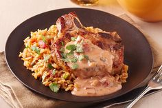 Chili powder and ground cumin team up with a cheesy, chunky salsa sauce to give this pork chop and rice dish Mexican-style appeal.