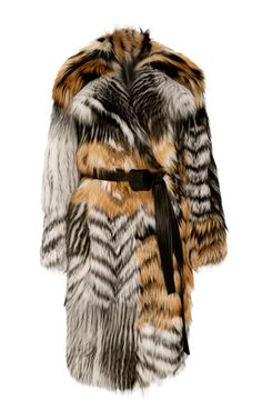 This **Jason Wu** coat is rendered in fox fur with a patchwork construction and an oversized fit.